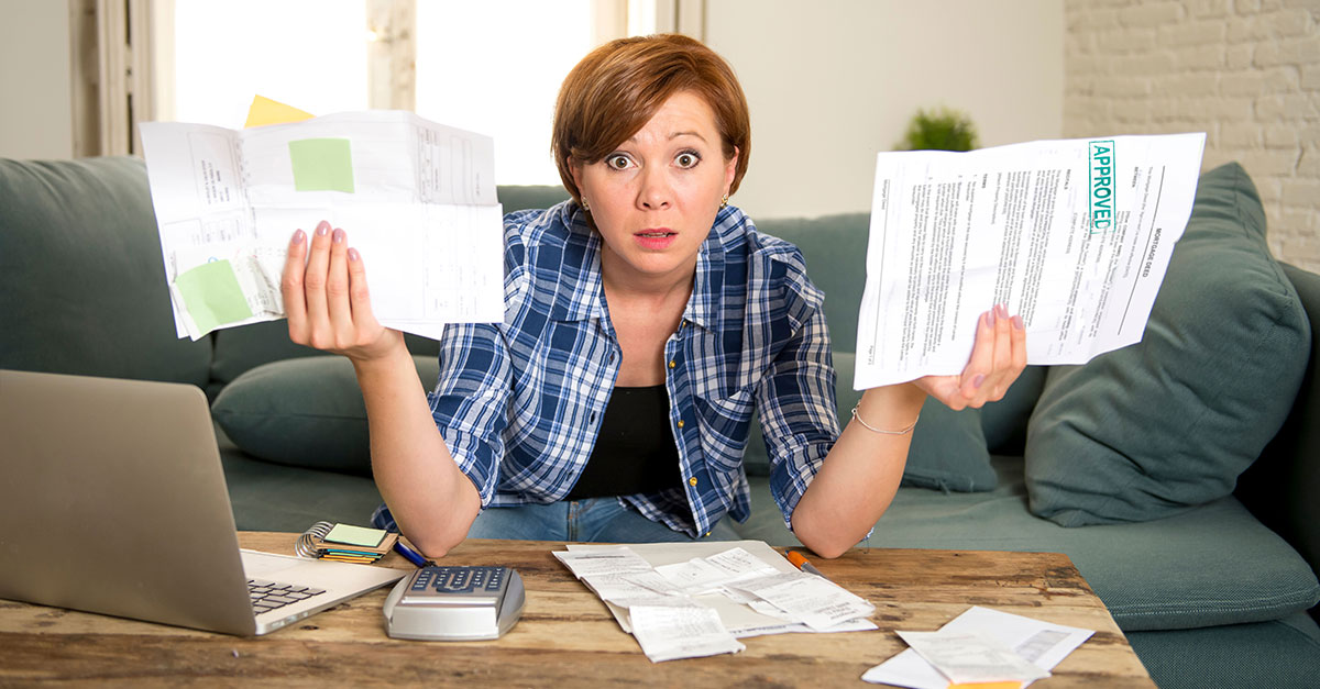 Distressed woman with too many bills